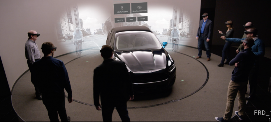 As designers wearing headsets move around an actual vehicle, the HoloLens scans and maps the environment